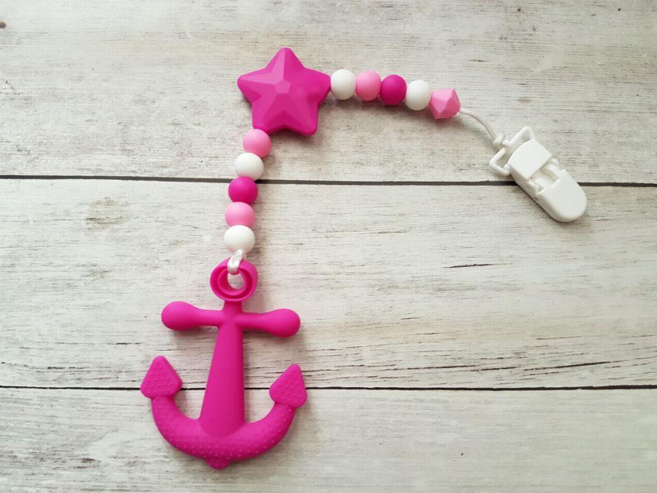 Egyágú színes szilikon rágóka (pink-feher)